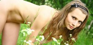 Domai model naked on grass