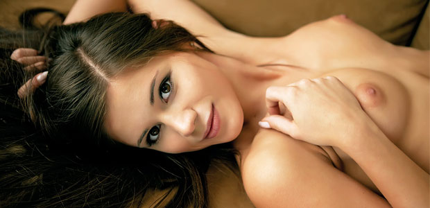 Little Caprice naked on a couch