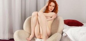 lusty-redhead-fingers-pussy