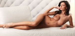 nude-brunette-posing-on-a-lounge-sofa
