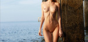 petite-nude-girl-anya-gets-wet
